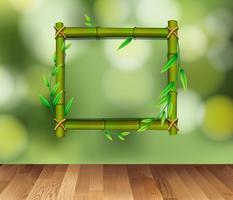 Bambusrahmen auf grünem Hintergrund