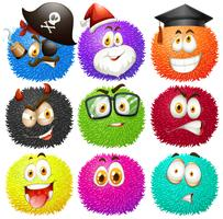 Colorful fluffy balls with faces