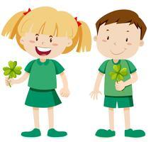 Boy and girl holding shamrocks