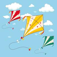 Three colorful kites in the blue sky