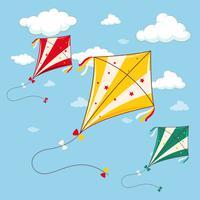 Drie kleurrijke vliegers in de blauwe hemel