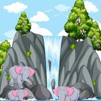Escena con elefantes en la cascada