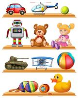 Different toys on wooden shelves