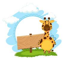 Giraffa che si leva in piedi vicino al segno di legno in bianco