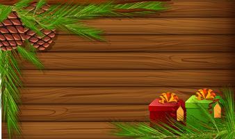Planche de bois avec pomme de pin et cadeaux