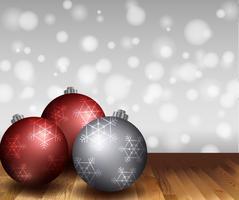 Tres bolas navideñas sobre suelo de madera.