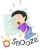 Boy sleeping with alarm clock snoozing