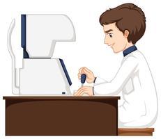 Homme travaillant à la machine de vérification des yeux