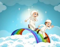 Pareja musulmana corriendo sobre el arco iris