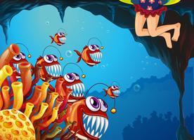 Een groep vissen kijkt naar het jonge meisje