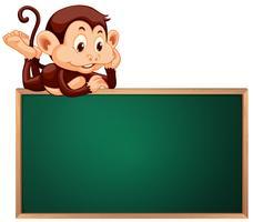 Um macaco bonito e banner de quadro-negro