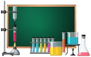 Blackboard template with science equipments in background