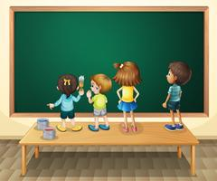 Children paintinging the blackboard in the room
