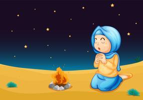 una niña cerca del fuego