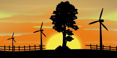 Silhouette scene with wind turbines in the field