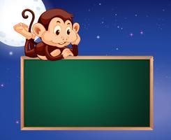 Macaco no fundo de céu noturno de quadro de quadro-negro