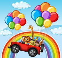 Animais selvagens em jipe sobre o arco-íris