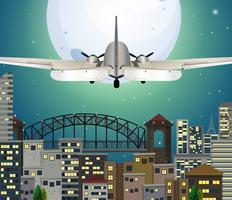 Vliegtuig die over stedelijke stad vliegen