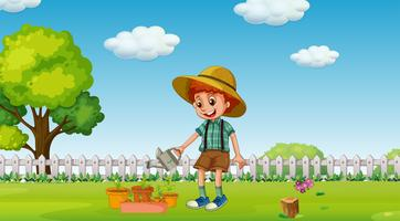 A Boy Watering Plants at Garden