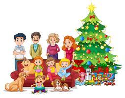 Familie vor Weihnachtsbaum