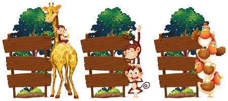 Wooden signs with giraffe and monkeys