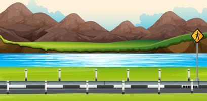 Scena di sfondo con fiume lungo la strada