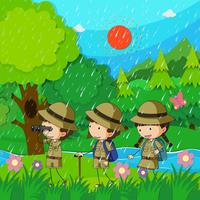 Children hiking in the rain