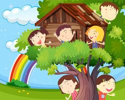 Many children playing on treehouse vector
