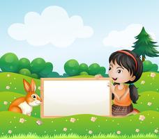 Une fille tenant un tableau vide avec un lapin