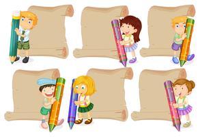 Pappersmallar med barn som håller kritor