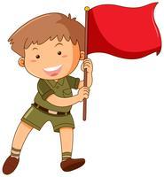 Petit garçon avec drapeau rouge