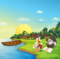 Um verme, um pato e um panda lendo na beira do rio