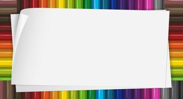 Plantilla de papel con lápices de colores en el fondo