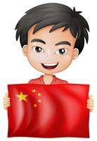 Niño feliz y bandera de china