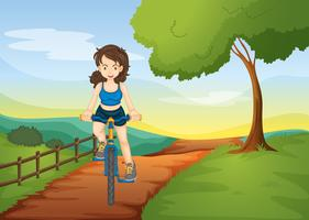 a girl riding on a bicycle vector