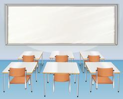 Sala de aula cheia de cadeiras e mesas