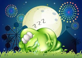 A fat monster sleeping at the carnival in the middle of the night