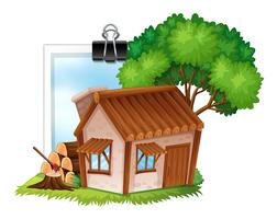 Wooden cottage on photoframe