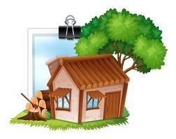 Wooden cottage on photoframe