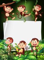 Diseño de frontera con monos en el bosque.