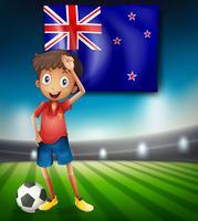 Bandeira da Nova Zelândia com jogador de futebol masculino