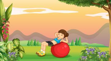 Donna che fa yoga con grande palla