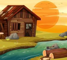 Casa de madeira velha pelo rio