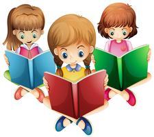 Tre tjejer läser böcker
