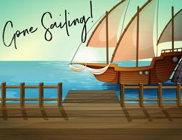 Navire à quai avec la phrase parti voile