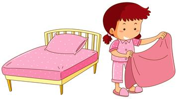 Little girl making bed