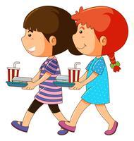 Dos niños con bandeja de comida.