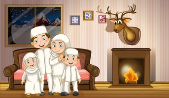 Muslim family in living room with fireplace