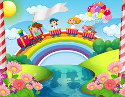 Children riding on train over rainbow