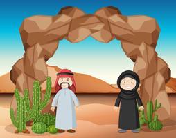 Arabische Menschen stehen in der Wüste